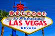 Welcome to Fabulous Las Vegas Nevada, popular landmark Las Vegas Sign on Las Vegas Strip at entrance of the city. Nevada, Unites States. Blue sky.