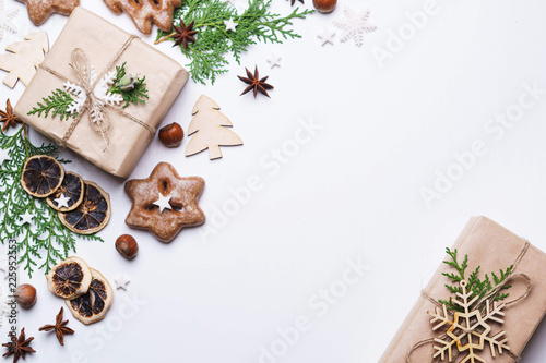 Leinwandbild Motiv Christmas and New Year celebration traditions concept. Composition of festive decorations, gingerbread cookies and gift box on white background with copy space for text design
