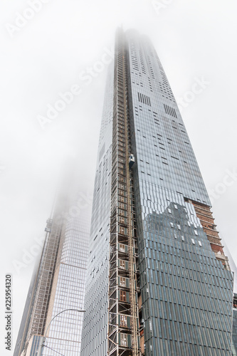A Very Tall Building With Mirror Windows Is Under Construction An