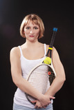 Sport Ideas. Portrait of Calm and Tranquil Caucasian Blond Female Posing With Tennis Racket. Against Black. - 225955309