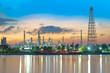 Leinwandbild Motiv oil refinery industry plant along twilight morning