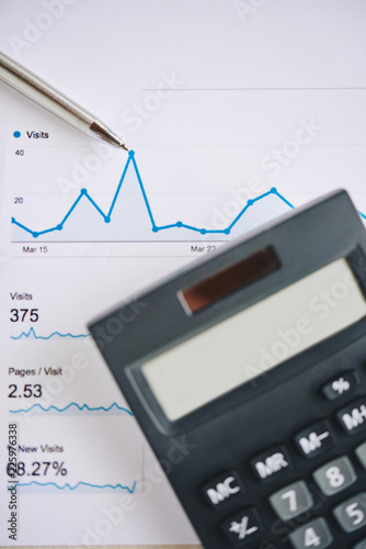 Chart with financial analytics, calculator and pen - 225976338