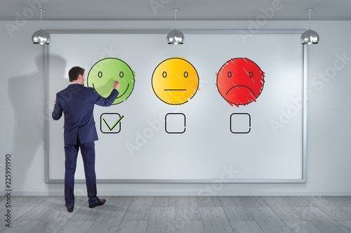 Businessman drawing thin line customer satisfaction rating on the wall