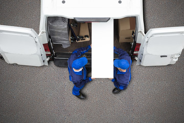 Mover Unloading Furniture From Vehicle