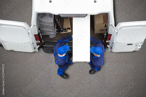 Mover Unloading Furniture From Vehicle - 225994532