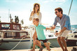 Quadro Happy family having fun, enjoying the summer time by the sea.