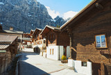Old street in Leukerbad in sunny day, canton of Valais , Switzerland. - 225998128