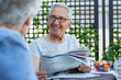 Leinwanddruck Bild - Senior man holding newspaper