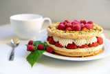 Delicious home made cake with fresh strawberries and rasberries on the white background. Isolated