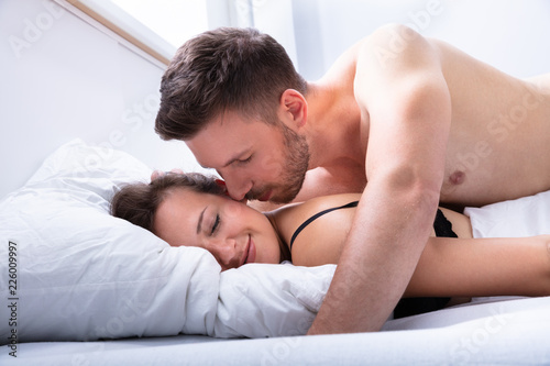 Leinwanddruck Bild Couple Being Intimate On Bed