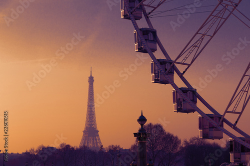 Paris, France, view on Concord square - observation wheel, Eiffel tower in the evening sunset sun rays. Selective focus