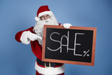 Man in santa claus costume with christmas banner