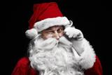 Man in santa claus costume winking - 226013143