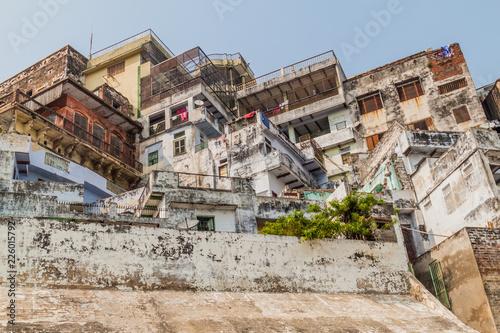 Foto Murales Buildings at a Ghat (riverfront steps) of sacred river Ganges in Varanasi, India