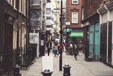 Soho in the UK, which was not that safe before, has become very colourful and peaceful neighbourhood for young people. Old brick buildings full of cafes and bars Photo taken on 30 September 2018 - 226025599