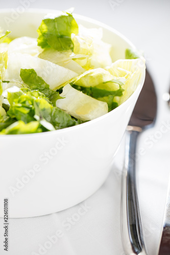 Foto Murales green salad in a white bowl. concept of healthy life