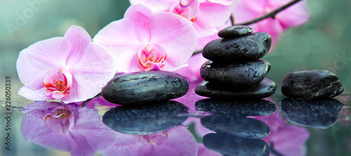 Leinwanddruck Bild Pink orchids flowers and spa stones . Spa background.