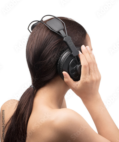Young Woman Listen Music in Headphones Isolated on White Background - 226053178