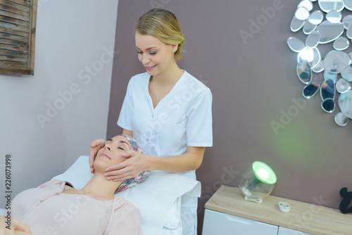 Leinwanddruck Bild Beautician giving facial massage
