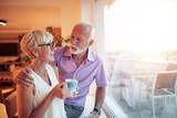 Senior couple enjoying in their home