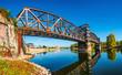 Leinwandbild Motiv Old Town Railway Bridge in Magdeburg, Elbe river and downtown at Autumn