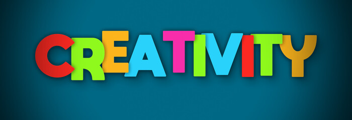 Creativity - overlapping multicolor letters written on blue background © Hepta