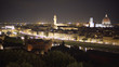Quadro In focus cityscape of Florence, Italy at night with bright city lights