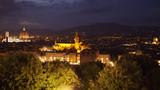 Brightly lit city view of Florence Italy with landmarks in the distance
