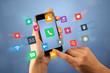 Leinwandbild Motiv Female fingers touching smartphone with colorful applications