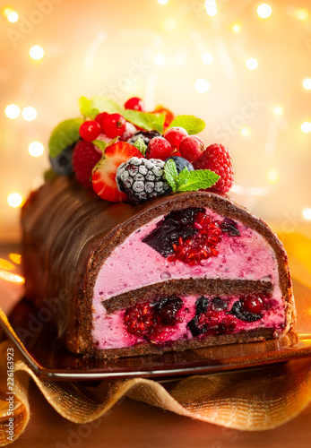 Sticker Chocolate and berries log cake.