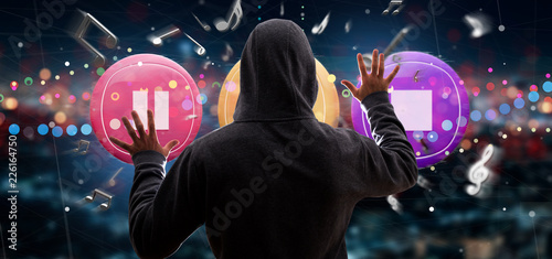 Man holding a Music button and notes playing  3d rendering - 226164750