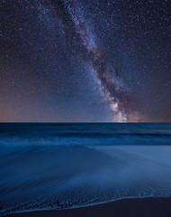 Vibrant Milky Way composite image over landscape of beach long exposure © veneratio