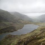 Landscape image of Llyn Idwal in Glyders mountain range in Snowdonia during heavy rainfall in Autumn - 226169129