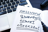 Strong and weak easy Password. Note pad and laptop.