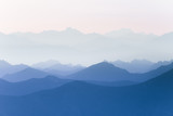 Colorful, abstract double exposure of mountains in sunrise. Minimalist scenery with color gradients. Tatra mountains in Slovakia, Europe.