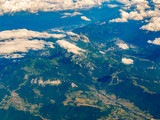 Top aerial view of villages in Switzerland mountains at summer time