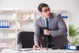 Businessman in industrial espionage concept - 226228167