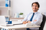 Young handsome businessman working in office - 226229359