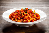 Pasta with tomato sauce and vegtables on wooden table - 226238306
