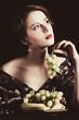 Leinwanddruck Bild - Portrait of beautiful rich woman with grapes.