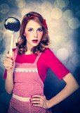 Redhead housewife with soup ladle on bokeh background - 226254502