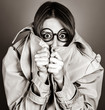 Quadro Hiding red-haired girl in glasses and cloak. Image in black and white color style