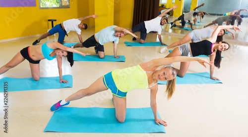 People exercising in fitness center