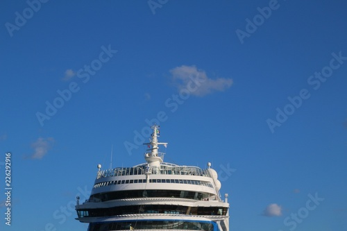 Ship's bridge of a cruise liner against blue sky - front view