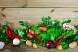 Vegetables assortment on wooden background, vegan cooking concept