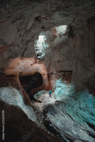Tourist in the Occidental Carpathians, Radesei Cave, Romania, Mysterious cave, Apuseni Mountains, Romania