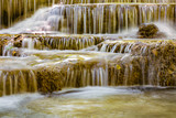 Close up motion stream waterfall, natural deep forest landscape background