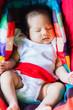 Adorable Baby girl sleep peacefully on car seat