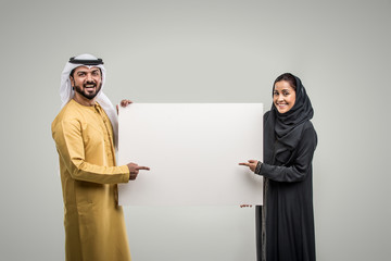 Arabian couple isolated on grey background