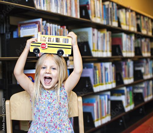Schoolgirl with bus toy - 226325922